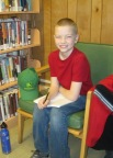 Connor writing at the Caribou Public Library for Breathe website